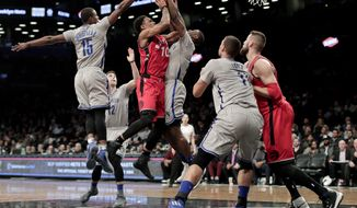 Toronto Raptors guard DeMar DeRozan (10) shoots against Brooklyn Nets guard Caris LeVert during the second quarter of an NBA basketball game, Tuesday, Jan. 17, 2017, in New York. (AP Photo/Julie Jacobson)