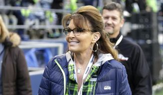 In a Thursday, Dec. 15, 2016, file photo, Sarah Palin, political commentator and former governor of Alaska, walks on the sideline before an NFL football game between the Seattle Seahawks and the Los Angeles Rams, in Seattle. (AP Photo/Scott Eklund, File)
