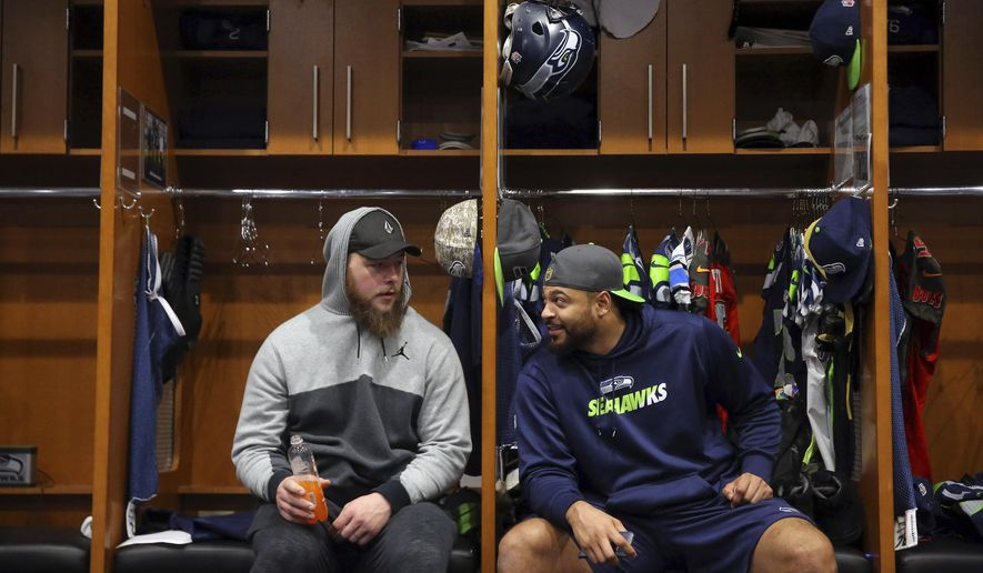Seattle Seahawks' Justin Britt, left, and Garry Gilliam talk as players clean out their lockers at the Virginia Mason Athletic Center in Renton, Wash., Sunday, Jan. 15, 2017. The team played their final game of the season Saturday. (Genna Martin/seattlepi.com via AP)