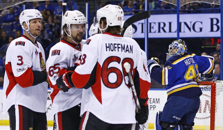 St. Louis Blues goalie Carter Hutton (40) looks on as Ottawa Senators' Jean-Gabriel Pageau (44) is congratulated by Marc Methot (3), Erik Karlsson, of Sweden, (65), andMike Hoffman (68) after scoring a goal during the first period of an NHL hockey game, Tuesday, Jan. 17, 2017, in St. Louis. (AP Photo/Billy Hurst)