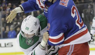 New York Rangers' Chris Kreider (20) and Dallas Stars' Cody Eakin (20) fight during the second period of an NHL hockey game Tuesday, Jan. 17, 2017, in New York. (AP Photo/Frank Franklin II)