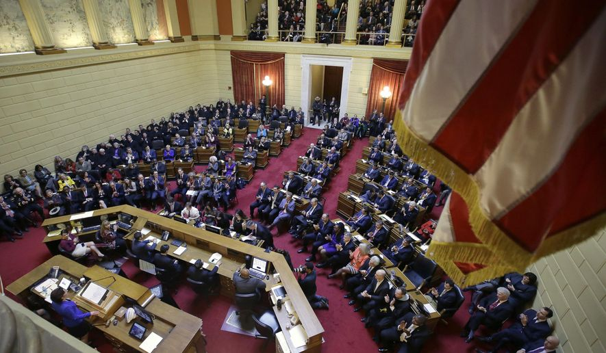 Rhode Island Democratic Gov. Gina Raimondo, below left, delivers her State of the State address to lawmakers and guests in the House Chamber at the Statehouse, Tuesday, Jan. 17, 2017, in Providence, R.I. (AP Photo/Steven Senne)