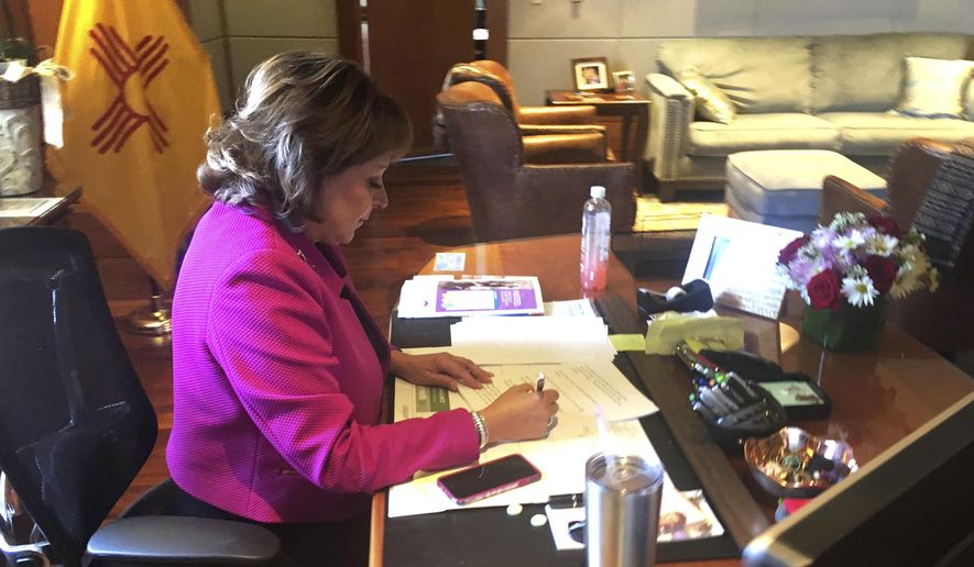 New Mexico Gov. Susana Martinez make final edits to her State of the State address on Tuesday, Jan. 17, 2017, in Santa Fe, N.M. The New Mexico legislature convened Tuesday amid partisan turmoil over how to handle the state's struggling budget. (AP Photo/Russell Contreras)