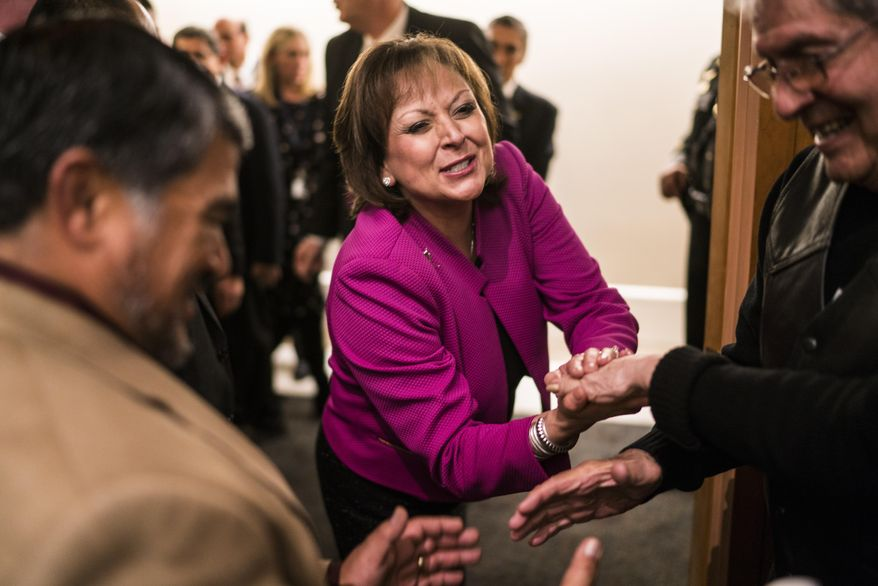 New Mexico Gov. Susana Martinez congratulated by supporters after she gave her State of the State address, Tuesday, Jan. 17, 2017, in Santa Fe, N.M. (AP Photo/Craig Fritz)