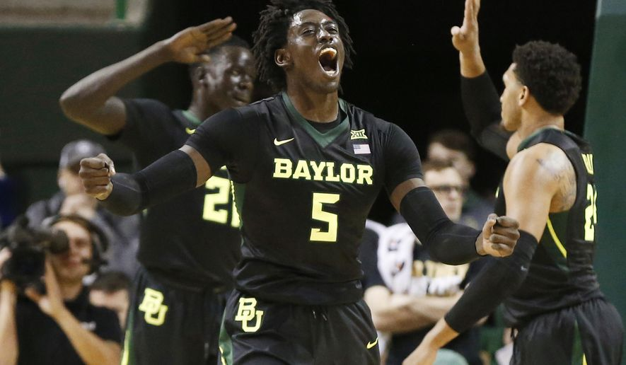 Baylor forward Johnathan Motley (5) reacts to a play against Texas in first half of an NCAA college basketball game, Tuesday, Jan. 17, 2017, in Waco, Texas. Baylor won 74-64. (Rod Aydelotte/Waco Tribune Herald via AP)