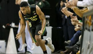 Baylor guard Al Freeman (25) celebrates sinking a three-point basket in the first half of an NCAA college basketball game against Texas on Tuesday, Jan. 17, 2017, in Waco, Texas. (AP Photo/Tony Gutierrez)