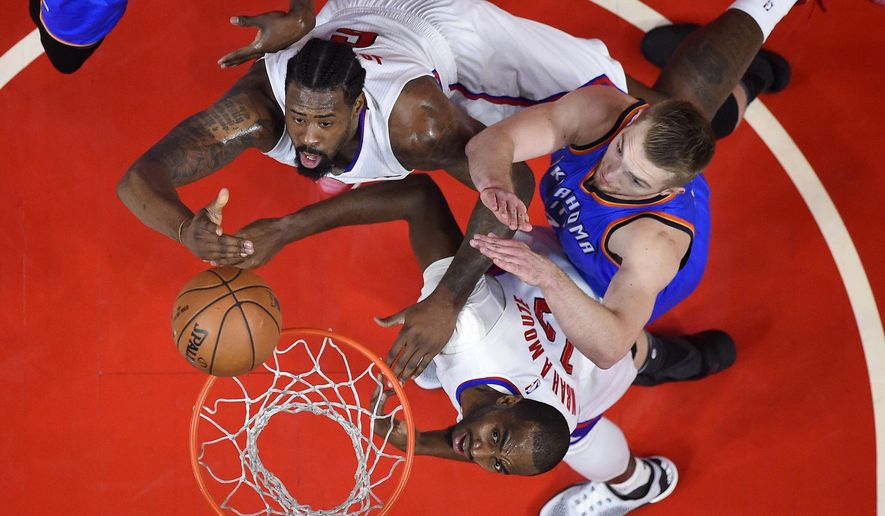 Los Angeles Clippers center DeAndre Jordan, top, shoots as Oklahoma City Thunder forward Domantas Sabonis, right, of Lithuania, defends and forward Luc Mbah a Moute, of Cameroon, watches during the first half of an NBA basketball game, Monday, Jan. 16, 2017, in Los Angeles. (AP Photo/Mark J. Terrill)