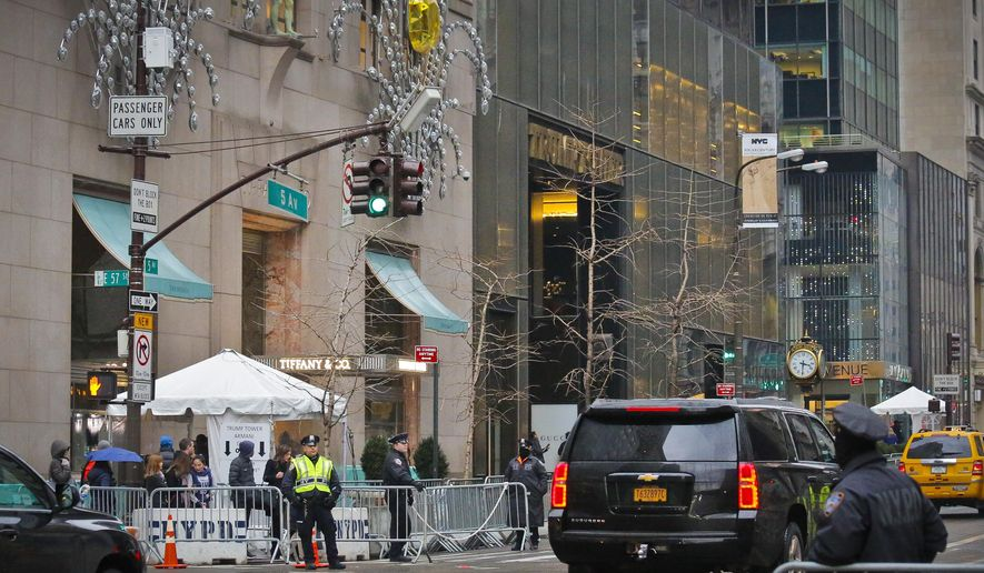"Police secure the area around Trump Tower and its neighbor Tiffany with barriers and a screening tent, Tuesday Jan. 17, 2017, in New York.  Tiffany said Tuesday that sales at its store on Manhattan's 5th Avenue tumbled 14 percent in November and December, compared with the same period last year, partly due to ""post-election traffic disruptions.""(AP Photo/Bebeto Matthews)"