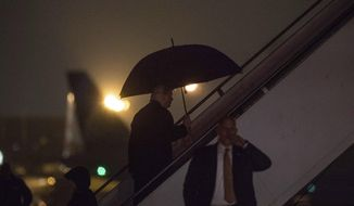 President-elect Donald Trump boards his airplane at LaGuardia Airport in New York, Tuesday, Jan. 17, 2017, to travel to Washington. (AP Photo/Andrew Harnik)