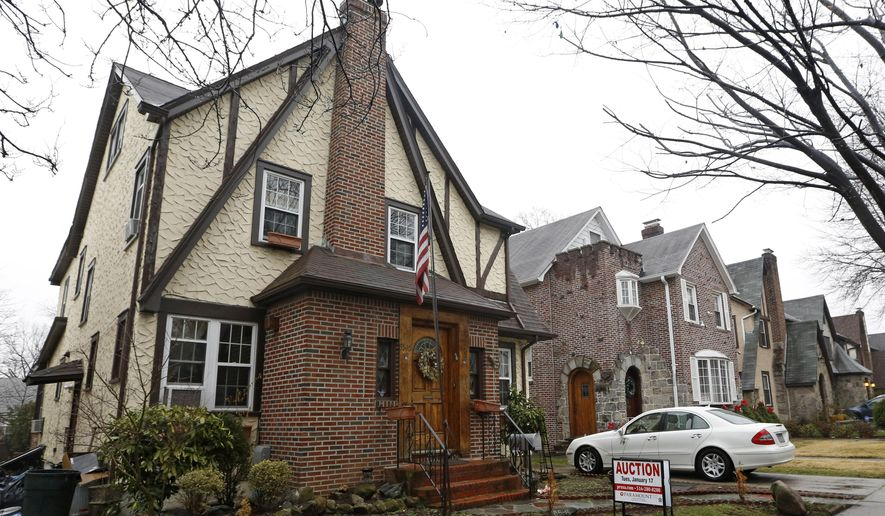 The boyhood home of President-elect Donald Trump, which is going back on the auction block, is shown, Tuesday, Jan. 17, 2017, in New York. Paramount Realty says the 1940 Tudor-style house in Jamaica Estates in Queens is up for auction for the second time in three months, with written bids due Tuesday afternoon.  (AP Photo/Kathy Willens)