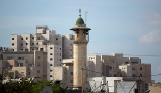 Mosques in Israel intone calls to prayer through loudspeakers five times a day. Prime Minister Benjamin Netanyahu is supporting a bill to reduce the volume. (Associated Press)