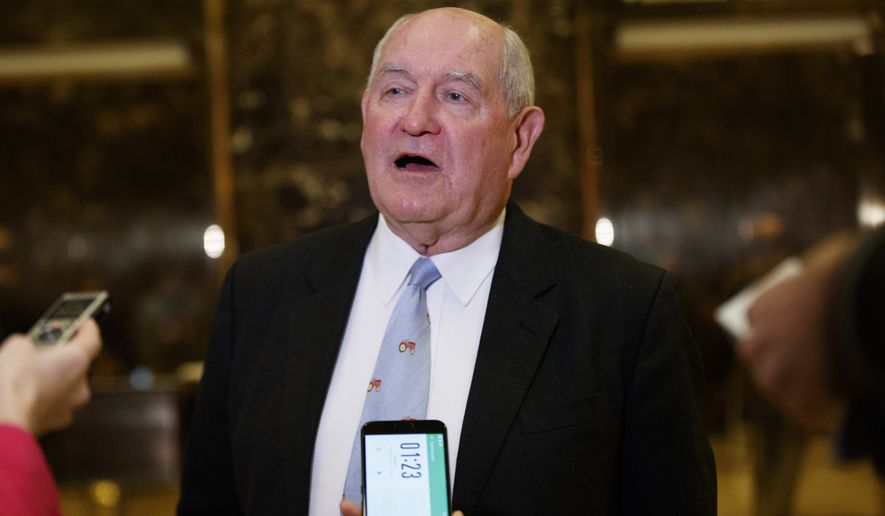 Former Georgia Gov. Sonny Perdue talks with reporters after meeting with President-elect Donald Trump at Trump Tower, Wednesday, Nov. 30, 2016, in New York. (AP Photo/Evan Vucci)