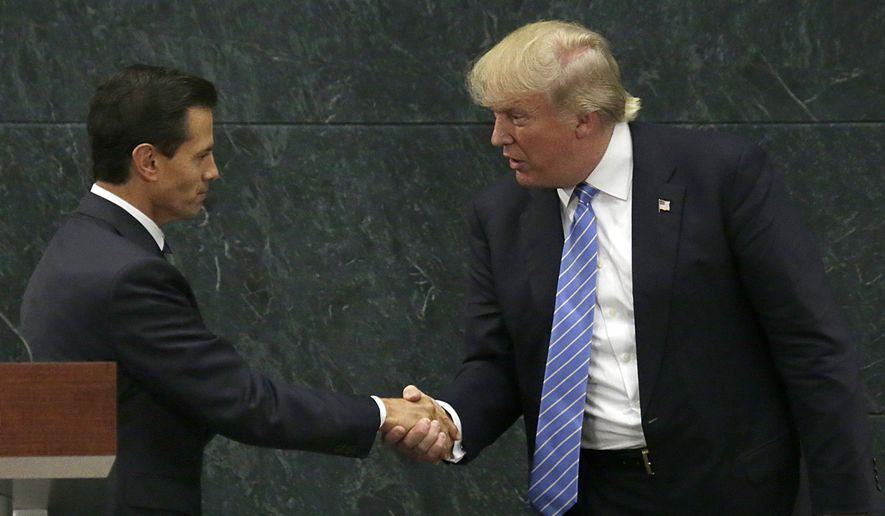 FILE - In this Aug. 31, 2016 file photo, Mexico's President Enrique Pena Nieto, left, and Republican presidential nominee Donald Trump shake hands after a joint statement at Los Pinos, the presidential official residence, in Mexico City. Before his swearing-in, Trump has already hurt Mexico's economy by pressuring automakers to shift factories out of Mexico and amid an uncertain economic outlook, the peso has plunged to all-time lows against the U.S. dollar. (AP Photo/Marco Ugarte, File)