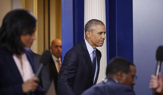 President Barack Obama arrives for his final presidential news conference, Wednesday, Jan. 18, 2017, in the briefing room of the White House in Washington. (AP Photo/Carolyn Kaster)