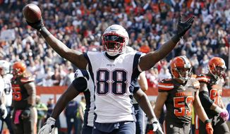FILE - In this Oct. 9, 2016, file photo, New England Patriots tight end Martellus Bennett celebrates a touchdown catch against the Cleveland Browns in the first half of an NFL football game in Cleveland. In his first season in New England, the Patriots tight end has brought a mellow vibe and unique personality to an organization that usually shies away from individuality. (AP Photo/Ron Schwane, File)