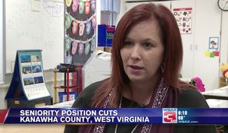 Rebecca Rhett, a kindergarten teacher at Overbrook Elementary in West Virginia, found out she may be out of a job after the Kanawha County School District announced layoffs by having teachers draw numbers from a hat. (WSAZ)