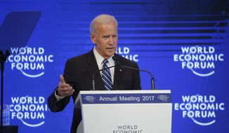 Then-U.S. Vice President Joe Biden delivers a speech on the second day of the annual meeting of the World Economic Forum in Davos, Switzerland, Wednesday, Jan. 18, 2017. (AP Photo/Michel Euler) ** FILE **