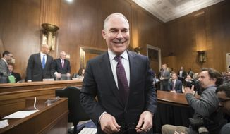 Environmental Protection Agency Administrator-designate Scott Pruitt arrives on Capitol Hill in Washington, Wednesday, Jan. 18, 2017, to testify at his confirmation hearing before the Senate Environment and Public Works Committee. (AP Photo/J. Scott Applewhite)