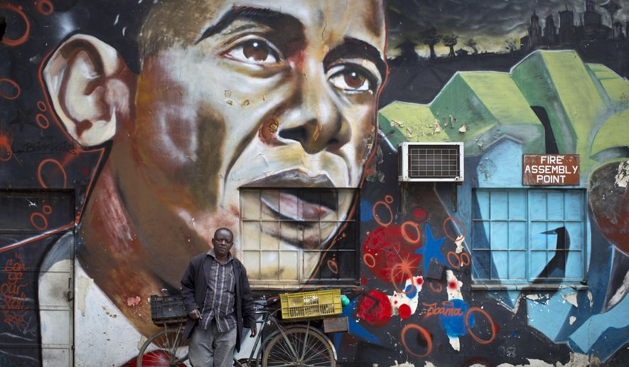 In this Wednesday, July 22, 2015, file photo, a man walks away after leaning his bicycle against a mural of President Barack Obama, created by the Kenyan graffiti artist Bankslave, at the GoDown Arts Centre in Nairobi, Kenya, ahead of the visit of Obama. Africa was electrified by the rise of Barack Obama, the first U.S. president of African descent, who took aim at the twin scourges of corruption and dictatorship and sent thousands of troops to fight one of the most terrifying disease outbreaks in decades. (AP Photo/Ben Curtis, File)