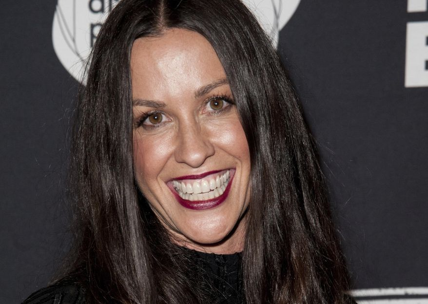 FILE - This June 20, 2014 file photo Alanis Morissette arrives at the 4th Annual Production Of The 24 Hour Plays After-Party in Santa Monica, Calif. Federal prosecutors say a business manager who embezzled more than $6.5 million from Morissette and other entertainment and sports figures has agreed to plead guilty. Jonathan Todd Schwartz agreed Wednesday, Jan. 18, 2017 to plead guilty in Los Angeles federal court to two felonies that carry a maximum of 23 years in federal prison. (Photo by Richard Shotwell/Invision/AP,File)