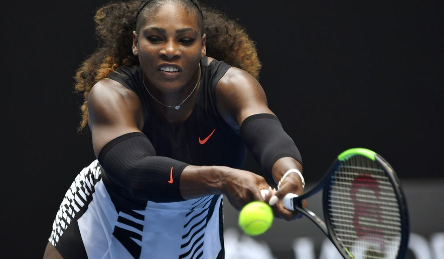 United States' Serena Williams reaches for a shot to Switzerland's Belinda Bencic during their first round match at the Australian Open tennis championships in Melbourne, Australia, Tuesday, Jan. 17, 2017. (AP Photo/Andy Brownbill)