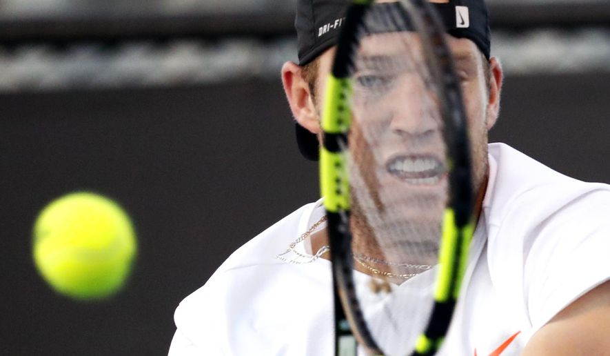 United States' Jack Sock makes a backhand return to Russia's Karen Khachanov during their second round match at the Australian Open tennis championships in Melbourne, Australia, Wednesday, Jan. 18, 2017. (AP Photo/Kin Cheung)