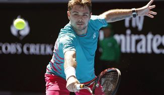 Switzerland's Stan Wawrinka makes a backhand return to United States' Steve Johnson during their second round match at the Australian Open tennis championships in Melbourne, Australia, Wednesday, Jan. 18, 2017. (AP Photo/Dita Alangkara)