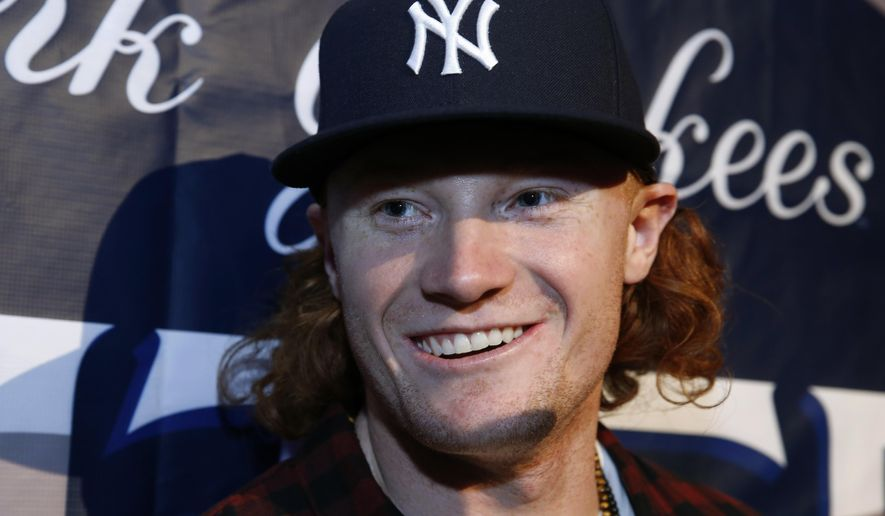 New York Yankees outfielding prospect Clint Frazier speaks to the media during an appearance at Hard Rock Cafe on Tuesday, Jan. 17, 2017, in New York. (AP Photo/Kathy Willens)