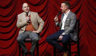 """New York Yankees general manager Brian Cashman, left, speaks to YES network broadcaster Ryan Ruocco onTuesday, Jan. 17, 2017, in New York. Cashman compared the Yankees now to when he first went to work for New York in the 1980s, what he described as a """"second-division team,"""" By the 1990s, the farm system produced Bernie Williams, Derek Jeter, Mariano Rivera, Andy Pettitte and Jorge Posada. (AP Photo/Kathy Willens)"""