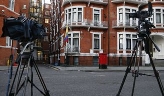 Cameras point at the Ecuadorian embassy where WikiLeaks founder Julian Assange has been holed up for more than four years in London, Wednesday, Jan. 18, 2017. (AP Photo/Frank Augstein)