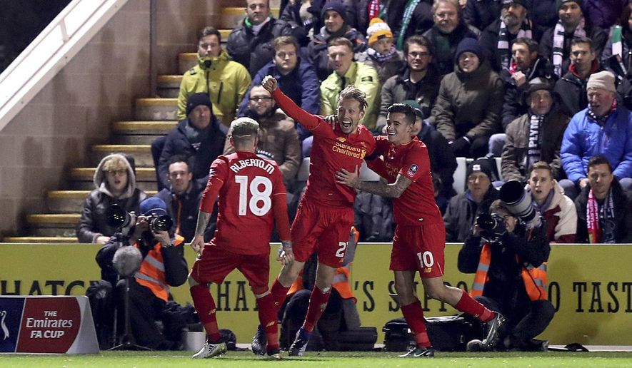 Liverpool's Lucas Leiva, center, celebrates scoring against Plymouth Argyle during the English FA Cup, third round replay match at Home Park, Plymouth, England, Wednesday Jan. 18, 2017. (Andrew Matthews/PA via AP)