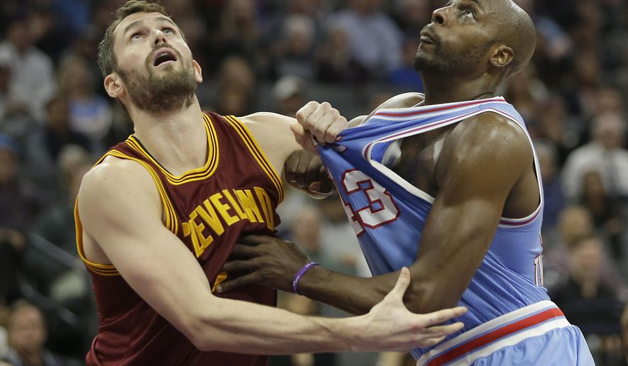 Cleveland Cavaliers forward Kevin Love, left, and Sacramento Kings forward Anthony Tolliver compete for rebounding position during the second half of an NBA basketball game Friday, Jan. 13, 2017, in Sacramento, Calif. The Cavaliers won 120-108. (AP Photo/Rich Pedroncelli)