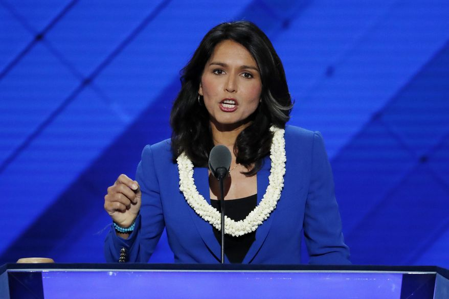 FILE - In this July 26, 2016 file photo, Rep. Tulsi Gabbard, D-Hawaii speaks at the Democratic National Convention in Philadelphia. Gabbard has made an unannounced trip to Syria and Lebanon, traveling to the region two months after she sat down with President-elect Donald Trump to discuss foreign policy.  (AP Photo/J. Scott Applewhite, File)