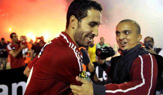 "FILE - In this Sunday, Nov. 10, 2013 file photo, Egyptian Al Ahly club player Mohamed Aboutrika is embraced by a fan after winning South Africa's Orlando Pirates, at the Arab Contractors stadium in Cairo, Egypt. Egyptian authorities on Wednesday, Jan. 18, 2017 have added one of the country's all-time greatest soccer players, Mohamed Aboutrika, to a terror watch and no-fly list over accusations he helped finance the Muslim Brotherhood, now banned as a terrorist organization. Authorities also say they've arrested nine alleged Brotherhood leaders for planning to ""disrupt order and security"" on the upcoming Jan. 25 anniversary of the 2011 Arab Spring uprising. (AP Photo/Osama Abdel Naby, File)"