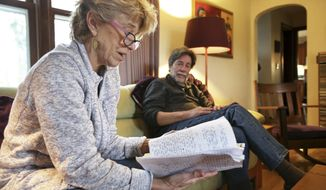 ADVANCE FOR WEEKEND EDITIONS, JAN 21-22 - In this Nov. 30, 2016 photo, Becky Briles, with her husband, David, at right, reads a diary entry of her son Max, at their home in Madison, Wis. Max died in October, 2016, at age 26 from anorexia. (Amber Arnold/Wisconsin State Journal via AP)