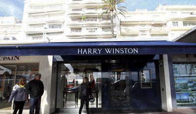Outside view of the Harry Winston jewelry store in Cannes, southern France, Wednesday, Jan. 18, 2017. A French official says a robber armed with a hand grenade and an automatic handgun has stolen diamond necklaces and other valuable jewelry for an estimated 15 million euros ($ 16 million) in the Harry Winston jewelry store in Cannes the French Riviera. (AP Photo)