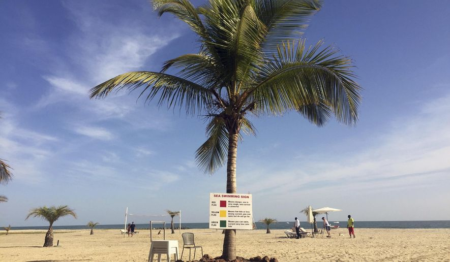 Tourists lay on the beach in Gambia's capital Banjul Tuesday Jan. 17, 2017.  Gambia's President Yahya Jammeh declared a state of emergency just two days before he is supposed to cede power after losing elections last month to President-elect Adama Barrow in the December 2016 election. Barrow is vowing to take power Thursday Jan. 19, despite Jammeh's refusal to leave. (AP Photo)