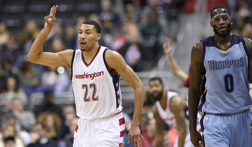 Washington Wizards forward Otto Porter Jr. (22) gestures next to Memphis Grizzlies forward JaMychal Green (0) after he hit a three-point basket during the first half of an NBA basketball game, Wednesday, Jan. 18, 2017, in Washington. (AP Photo/Nick Wass)