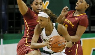 Iowa State guard TeeTee Starks, left, and Seanna Johnson, right defend as Baylor's Nina Davis, center positions for a shot in the first half of an NCAA college basketball game, Wednesday, Jan. 18, 2017, in Waco, Texas. (AP Photo/Tony Gutierrez)