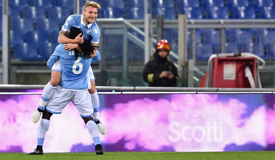Lazio's Ciro Immobile, top, celebrates after scoring during the Italian Cup, Round of 16 soccer match between Lazio and Genoa at the Rome Olympic stadium Wednesday, Jan. 18, 2017. (Ettore Ferrari/ANSA via AP)