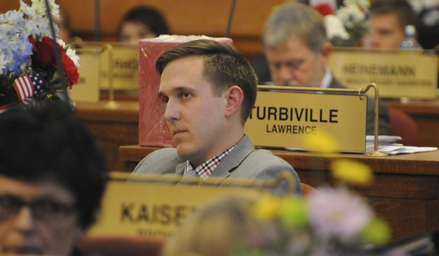 In this Wednesday, Jan. 18, 2017 photo, Republican Rep. Mathew Wollmann sits on the House floor in Pierre, S.D. The House decided to investigate Wollmann, who told reporters that he had sexual contact with interns during the past two legislative sessions. (AP Photo/James Nord)