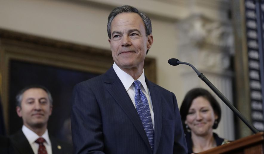 FILE - In this Jan. 10, 2017, file photo, Texas Speaker of the House Joe Straus, R-San Antonio, stands before the opening of the 85th Texas Legislative session in the House chambers at the Texas State Capitol after he was re-elected for a fifth consecutive term in Austin, Texas. Straus has branded as bad for business a Texas proposal barring transgender people from using public restrooms of their choice that's been championed by his state's leading conservatives despite echoing a law that caused upheaval in North Carolina.  (AP Photo/Eric Gay, File)