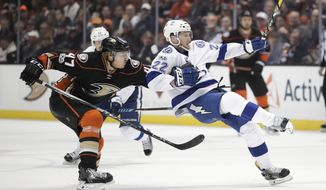 Tampa Bay Lightning's Erik Condra, right, is pulled by Anaheim Ducks' Hampus Lindholm, of Sweden, during the first period of an NHL hockey game Tuesday, Jan. 17, 2017, in Anaheim, Calif. (AP Photo/Jae C. Hong)
