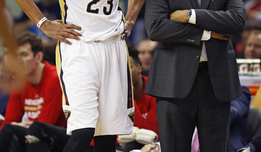 New Orleans Pelicans forward Anthony Davis (23) talks with head coach Alvin Gentry in the second half of an NBA basketball game against the Orlando Magic in New Orleans, Wednesday, Jan. 18, 2017. The Pelicans won 118-98. (AP Photo/Max Becherer)