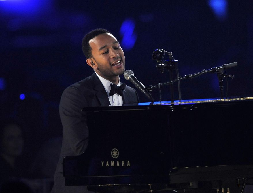FILE - In this Feb. 8, 2013, file photo, John Legend performs onstage at the Los Angeles Convention Center in Los Angeles. Legend, Carrie Underwood, Keith Urban and Metallica are set to perform at the Grammy Awards on Feb. 12, 2017. (Photo by Chris Pizzello/Invision/AP, File)