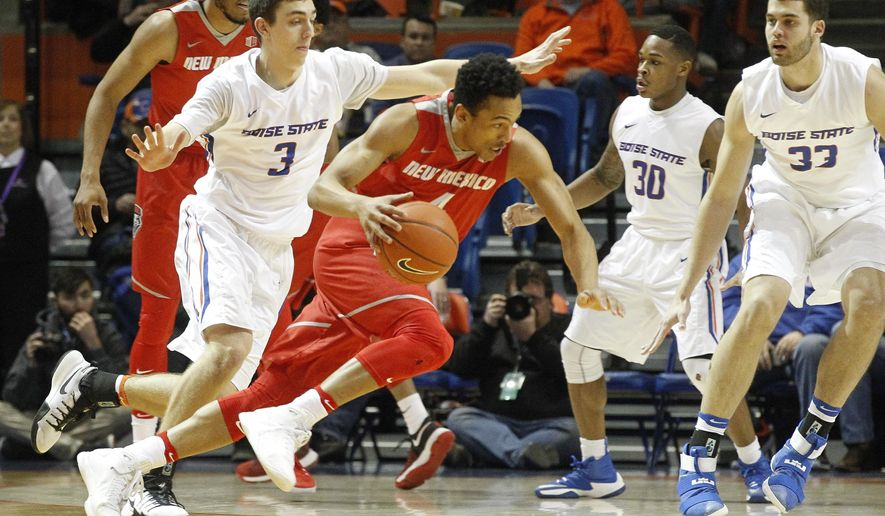 New Mexico's Elijah Brown (4) moves the ball past Boise State's Justinian Jessup (3) during the first half of an NCAA college basketball game in Boise, Idaho, Tuesday, Jan. 17, 2017. (AP Photo/Otto Kitsinger)