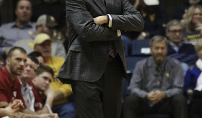 Oklahoma coach Lon Kruger watches his team playing against West Virginia during the second half of an NCAA college basketball game, Wednesday, Jan. 18, 2017, in Morgantown, W.Va. (AP Photo/Lindsay Cook)