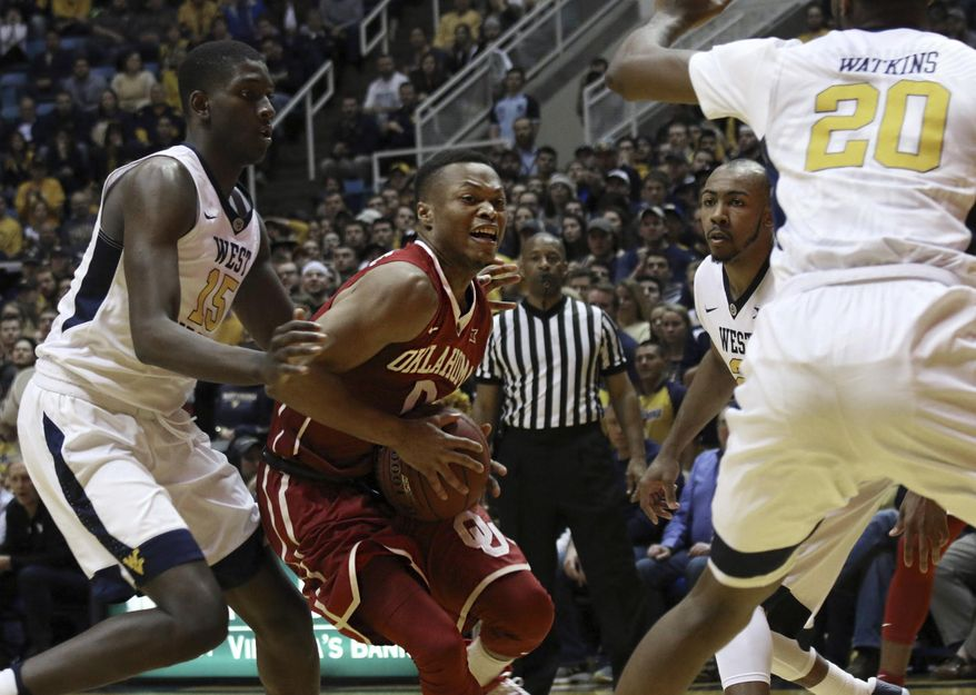 Oklahoma guard Darrion Strong-Moore (0) attempts a shot during the first half of an NCAA college basketball game, Wednesday, Jan. 18, 2017, in Morgantown, W.Va. (AP Photo/Lindsay Cook)