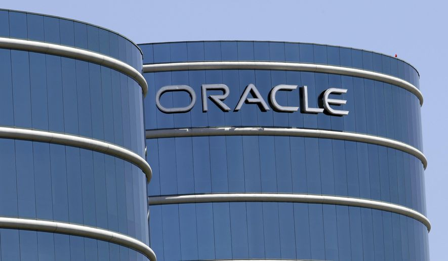 "FILE - This June 18, 2012, file photo shows Oracle headquarters in Redwood City, Calif. The Labor Department is suing Oracle, claiming that the technology giant pays white male workers more than their non-white and female counterparts with the same job titles. In a statement issued Wednesday, Jan. 18, 2017, Oracle  called the lawsuit ""politically motivated, based on false allegations and wholly without merit."" (AP Photo/Paul Sakuma, File)"