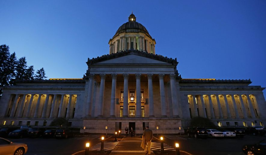 FILE - This March 10, 2016, file photo, shows the Legislative Building at dusk at the Capitol in Olympia, Wash. The conversation about paid family leave in Washington state is being revived a decade after passage of a law that was never implemented because lawmakers didn't pay for it. Now lawmakers from the state where companies like Microsoft and Amazon give their employees the benefit are introducing bills for a broader law that would give workers more paid time off, a higher weekly benefit and a steady funding stream. The first hearing on one of the bills happens Thursday, Jan. 19, 2017. (AP Photo/Ted S. Warren, File)